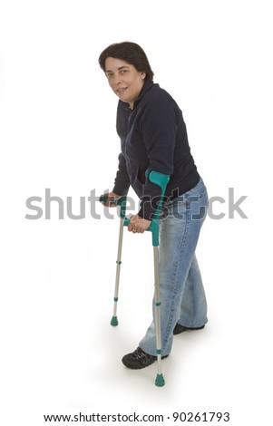 Woman with crutches isolated on white background