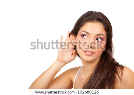 Woman With cupped hand to ear listening to gossip scandal or secrets