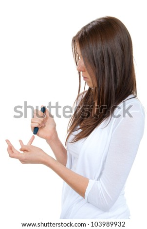 Woman with Diabetes lancet in hand prick finger to make punctures to obtain small blood specimens for blood glucose, hemoglobin level test using glucometer isolated on a white background