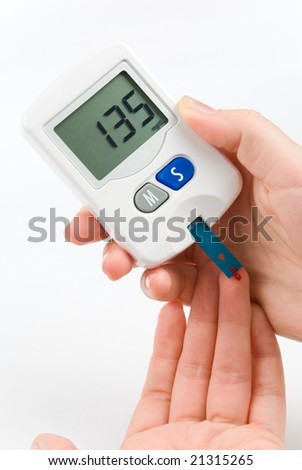 Woman with diabetes measuring blood sugar level