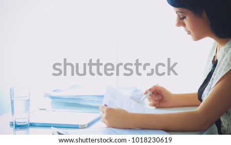 Woman with documents sitting on the desk #1018230619