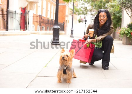 Stock Photo woman with dog and shopping bags