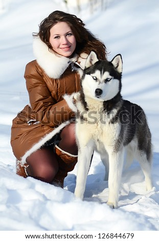 Woman with dog Husky in the winter
