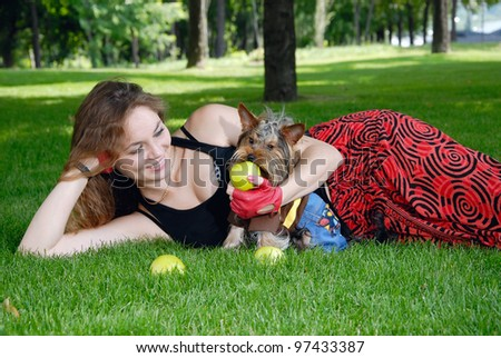 Woman with dog in the park - stock photo
