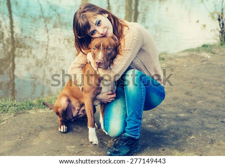 Woman with dog nature near lake
