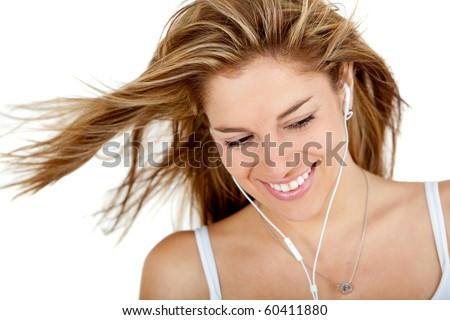 Woman with earphones listening to music - isolated over a white background
