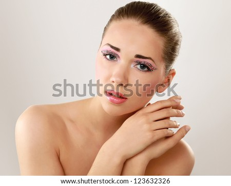 Woman with exotic style makeup, isolated on white  background