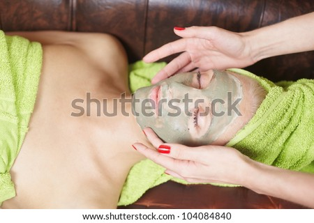 Woman with face mask in spa