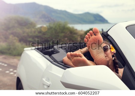 Woman with feet up in luxury convertible, relaxing after walking. Hawaii, USA. #604052207