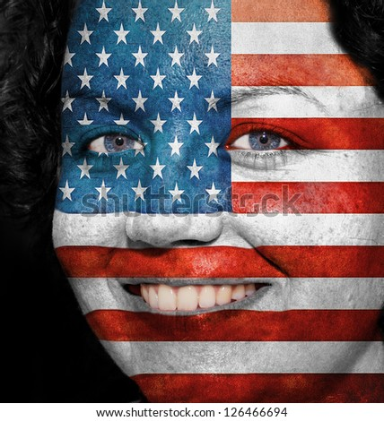 Woman with flag painted on her face to show USA support in sports