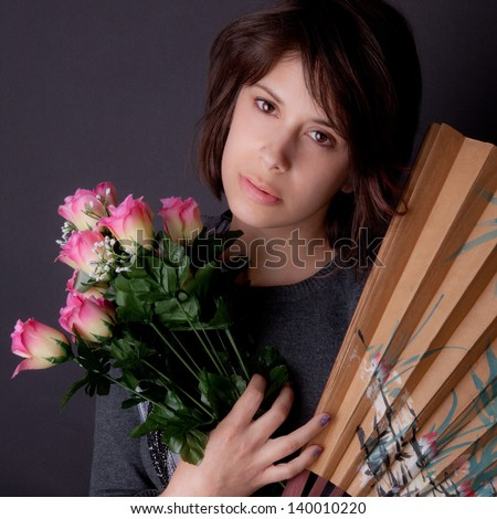 Woman With Flowers and Fan