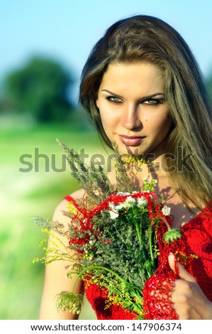 Woman with flowers in a field