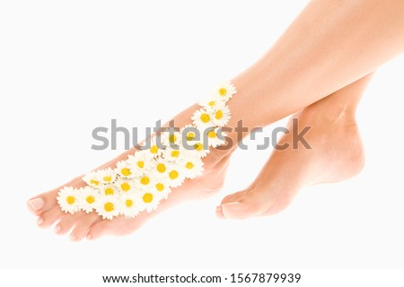 Woman with flowers on foot