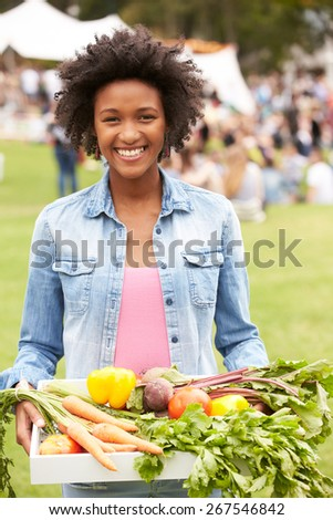 Woman With Fresh Produce Bought At Outdoor Farmers Market