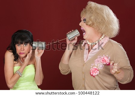 Woman with friend in drag talk through tin cans