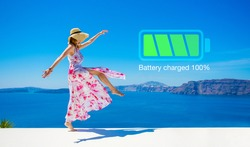 Woman with fully charged inner battery, concept of taking a break and recharging yourself