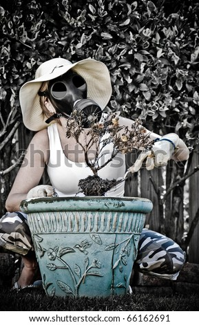 Woman with Gas Mask On Digging up Dead Flowers