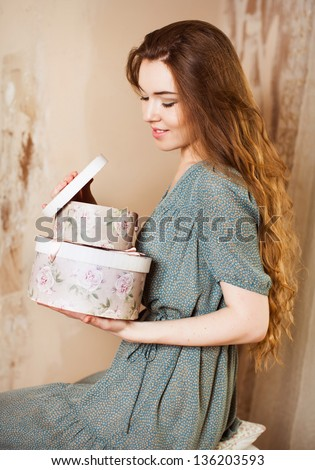 woman with gifts open box