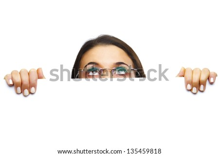 Woman with glasses holding a sign - looking skywards - stock photo