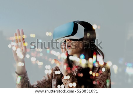 Woman with glasses of virtual reality. Future technology concept. #528831091