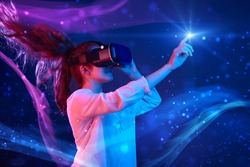 Woman with glasses of virtual reality. Future technology concept. Colorful neon lights.