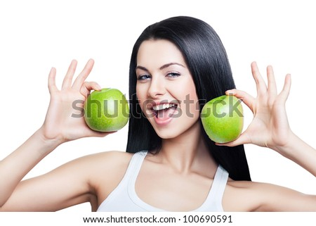 woman with green apples in hands on white background