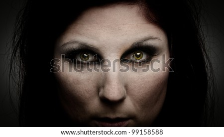 Woman with green eyes and an intense stare