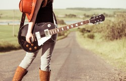 woman with guitar at freeway