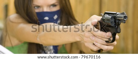 Woman with Gun Bandanna Bandit Points Shoots Handgun Revolver Down Range
