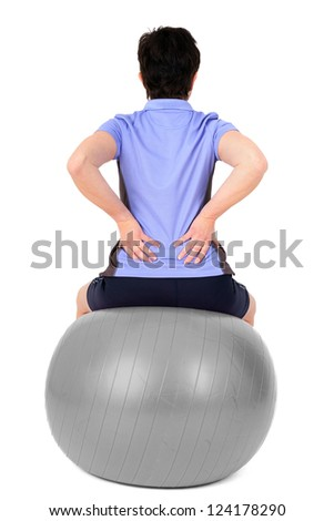 Woman with gym ball doing exercises