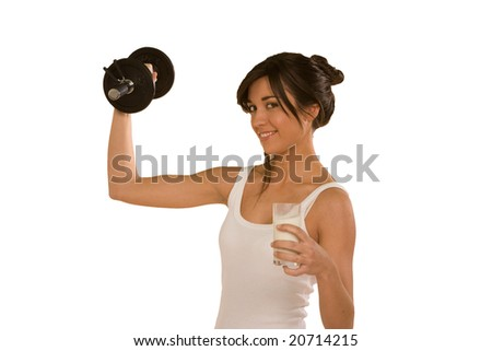 woman with gym weight and milk
