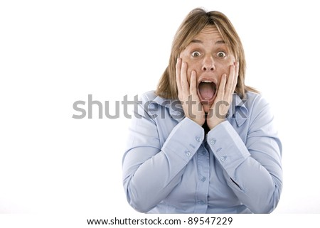woman with hands on face and mouth open in surprise