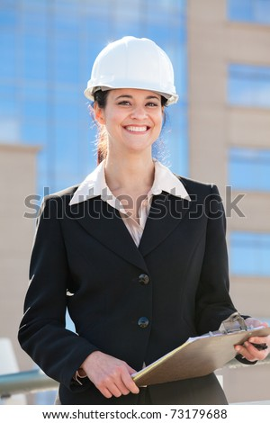 Woman with hard hat and clipboard