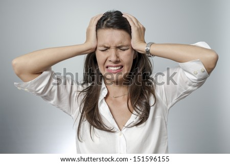 woman with headache and negative face expression