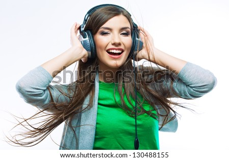 Woman with headphones listening music .Music teenager girl dancing against isolated white background