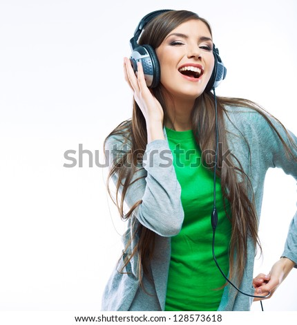 Woman with headphones listening music . Music teenager girl dancing against white.  background isolated . - stock photo