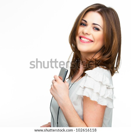 Woman with headphones listening  music on mp3 player. Music teenager girl dancing against isolated white background - stock photo