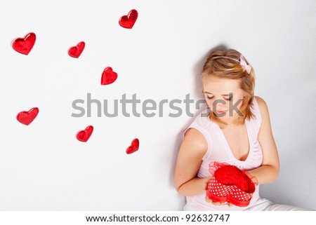 Woman with hearts flying out from the box