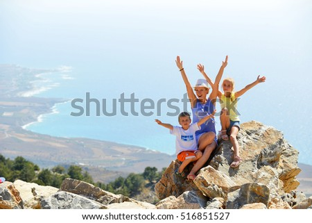 woman with her children on top of mountain #516851527