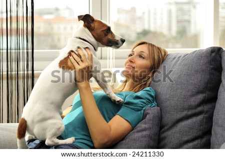 woman with her dog in her apartment