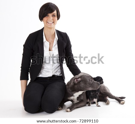 Woman with her dogs chihuahua and English Staffordshire
