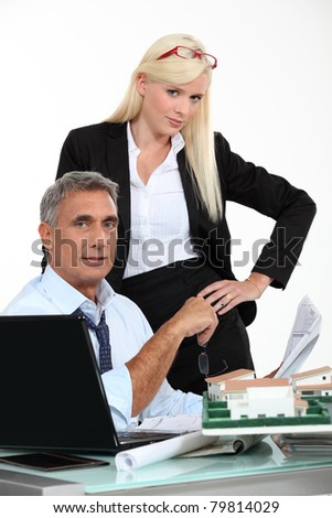 Woman with her hands on her hips standing in an architect's office