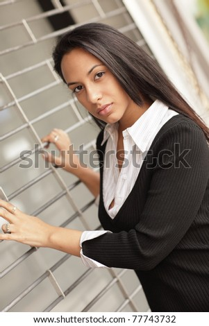 Woman with her hands on the gate