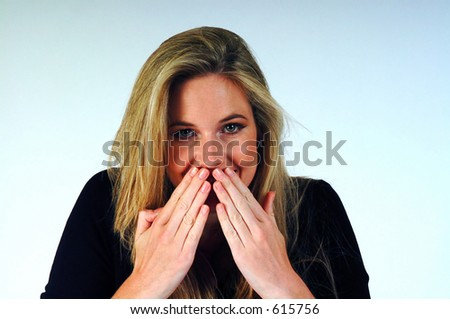 Woman with her hands over her mouth.