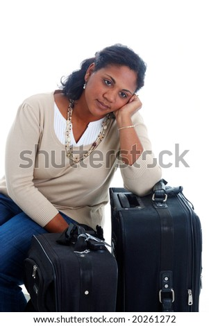 Woman with her suitcases ready to travel