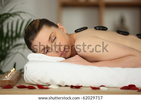 Woman with hot stones massage
