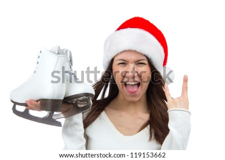 Woman with ice skates getting ready for ice skating winter sport activity in ����hristmas santa hat screaming or yelling isolated on a white background
