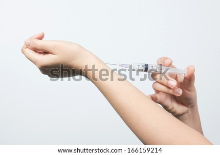 woman with injection needle on her arm,Close up of a woman patient injection needle on her arm