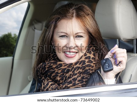 woman with keys of new , hire or rental car or just passed driving test