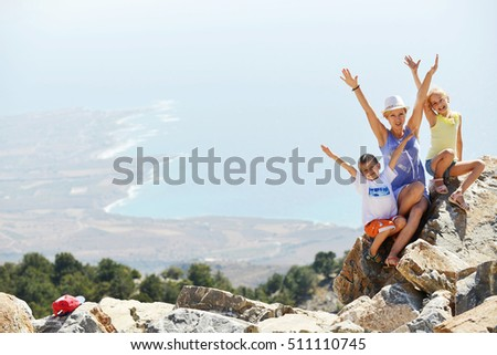woman with kids on top of mountain  #511110745